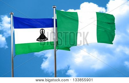 Lesotho flag with Nigeria flag, 3D rendering