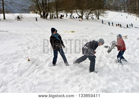 children have a snowball fight in the white beautiful snowy area