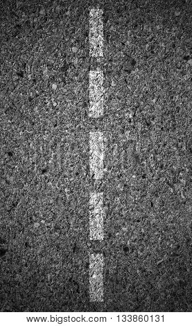 Highway surface with two yellow lines. Asphalt background