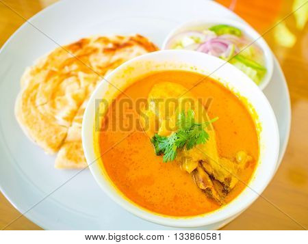 Close up of Muslim style of chicken curry or chicken mussaman curry in white bowl