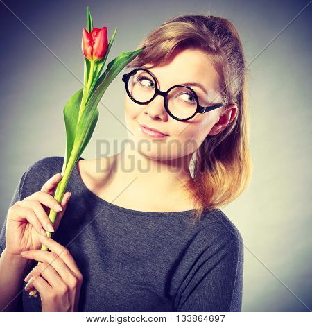 Dreams and hope concept. Young blonde smiling woman dreaming about something positive. Girl with tulip dream of future celebration.