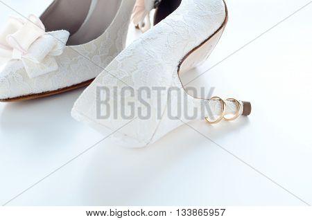 Gold wedding rings for wedding on white background love
