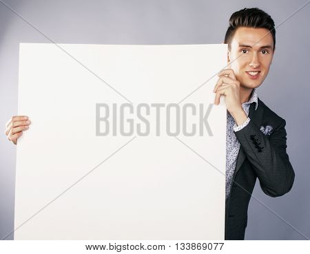 young handsom businessman in suit with poster empty copy space smiling, business people concept