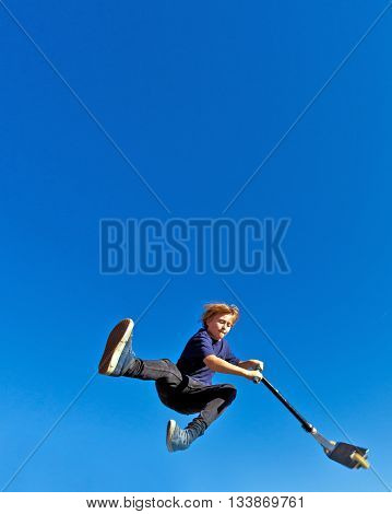 Child Going Airborne With  Scooter