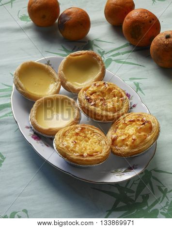 Meringue egg tarts and Portuguese egg tarts.