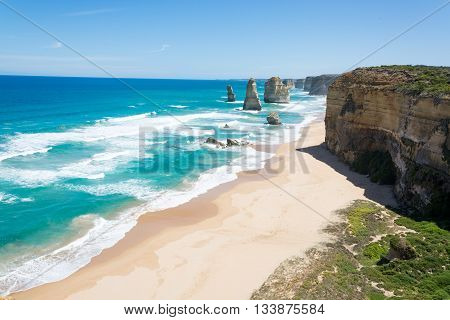 far away view of tall cliffs standing out of the sea coastline twelve apostles great ocean road