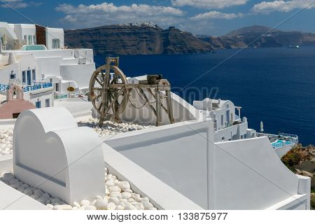 Rotating wooden wheel in the village of Oia. Santorini Island. Greece.
