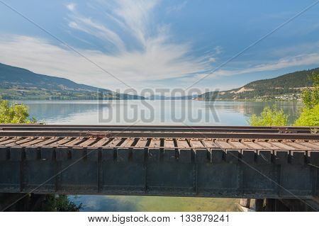 Landscape of Wood Lake from a small train bridge in Oyama British Columbia.