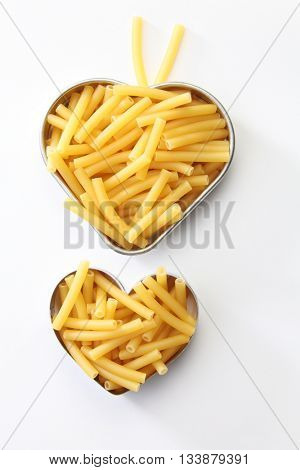 Maccheroni dry pasta on the heart shape container