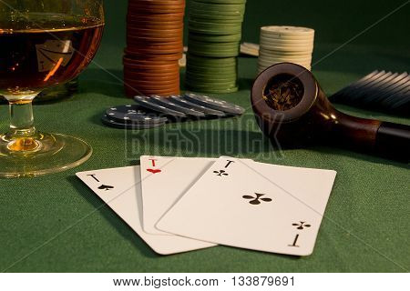 Poker concept with chips and cards on the green table