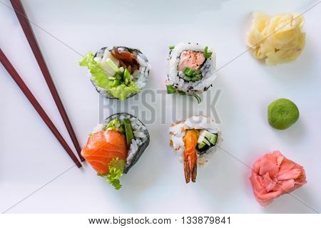 Sushi set with chopsticks on the plate