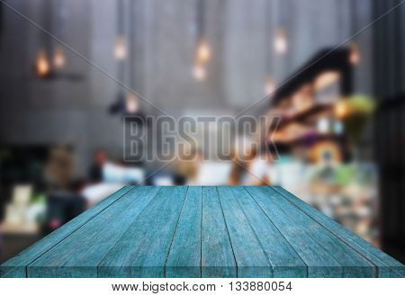 Blue table top wooden with blurred background in coffee shop, stock photo