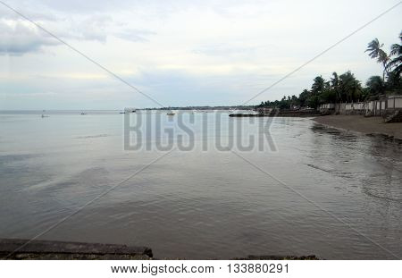 A view of the shoreline and public beach in Cebu City, the Philippines, circa July, 2011.