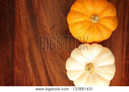 Background pumpkin yellow and white on a wooden floor.