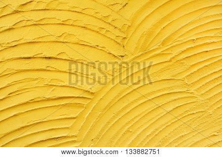 Yellow plaster texture close up for background