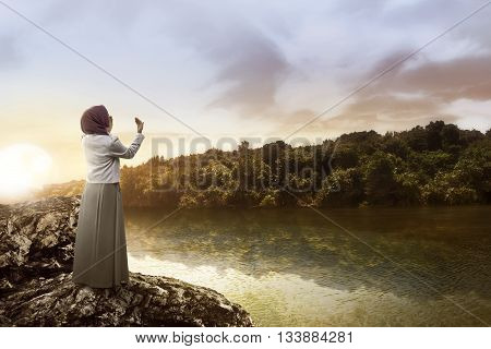 Muslim Woman Praying At The Lake