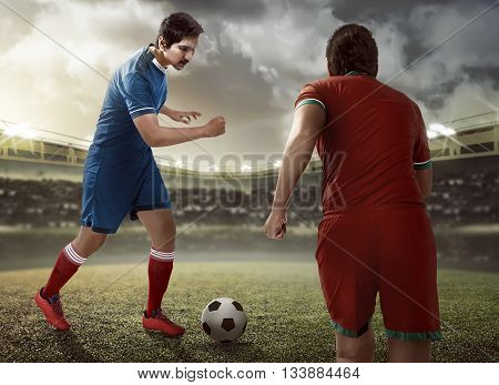 Football Player Dribbling Ball Intercepted By Other