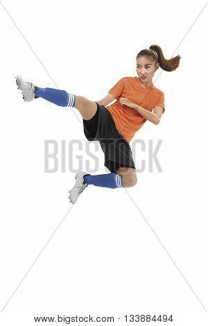 Asian Female Football Player Kick Ball