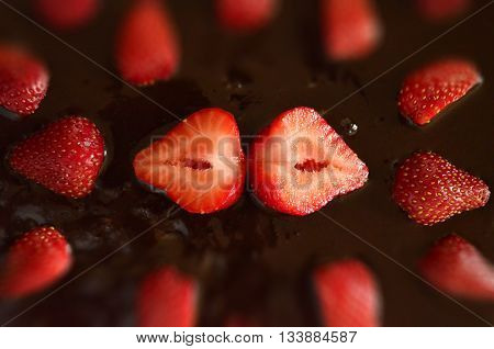 Desert Strawberries and Chocolate Carrot Cake with focus in the center. Red, Brown, Food, Vitamin C Strawberries, Cake from Above