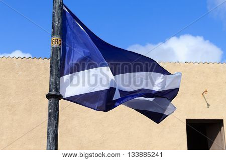 Scottish flag waving in the wind detail