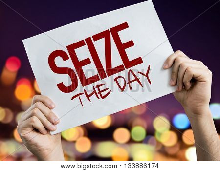 Seize the Day placard with night lights on background