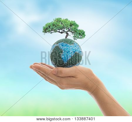 Earth in hand isolated on white background. Environment and ecology concept.