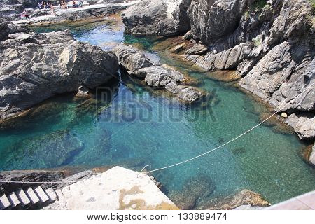 Clear rock pool in Riomaggiore, Cinque Terre Italy