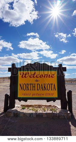 Welcome to North Dakota road sign with blue sky