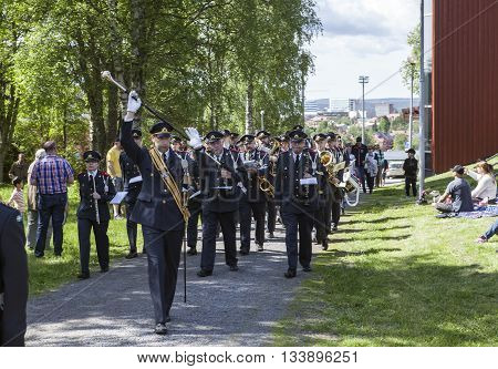 UMEA, SWEDEN ON JUNE 06. View of the Swedish Home Guard, National Security Forces on June 06, 2016 in Umea, Sweden. Music and parade to the venue. Unidentified people in action. Editorial use.