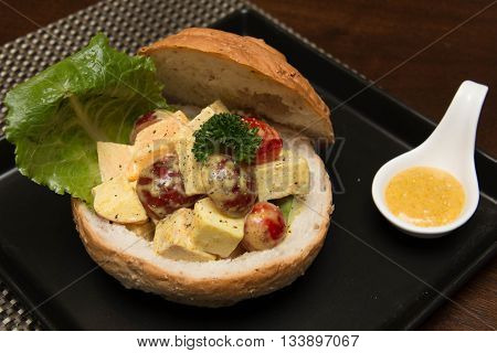 A chicken curry salad in bread bowl