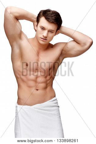 Handsome young man sniffing his armpit isolated on white