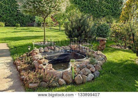 Artificial Pond In The Garden