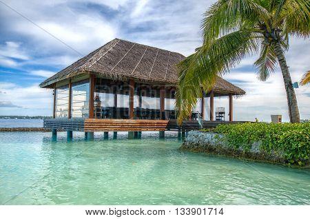 Small restaurant on sea water near beach Maldives