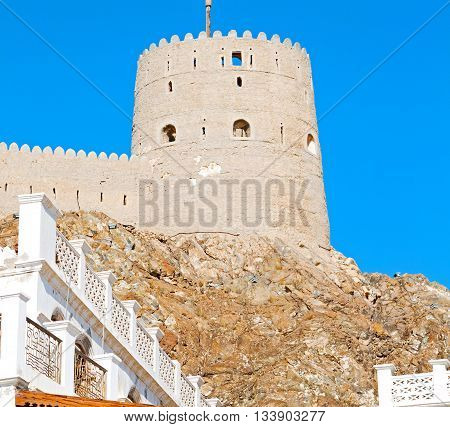 In Oman Muscat Rock  The Old Defensive  Fort Battlesment Sky And  Star Brick