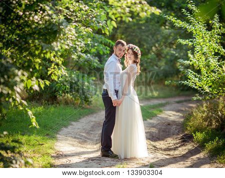Bride and groom on their wedding day in summer garden