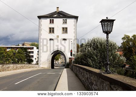 The old Lahn Bridge with the tower in Limburg an der Lahn city in Germany. Limburg an der Lahn is a beautiful touristic city in the federal state Hessen on the Lahn river.