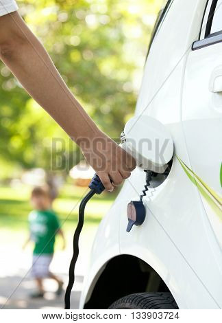 Hand holding plug for charging of an electric car