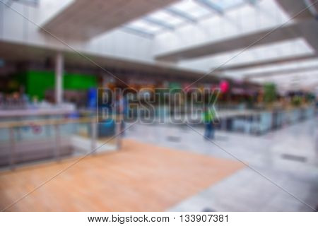 Blurred interior in shopping center. Shopping malls. Center passage in super market discount at the blur background.