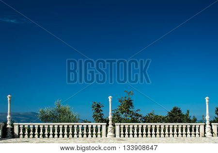 Antique terrace with clear blue sky background. white balustrade and empty terrace . mediterranean architecture