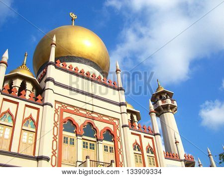 Mosque with golden dome and blue sky. Beautiful mosque in Singapore.
