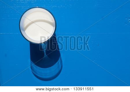 Glass of milk on the blue wooden table - Flat Lay Photography