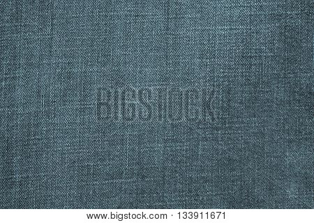the textured background from denim or rough cotton material of indigo color