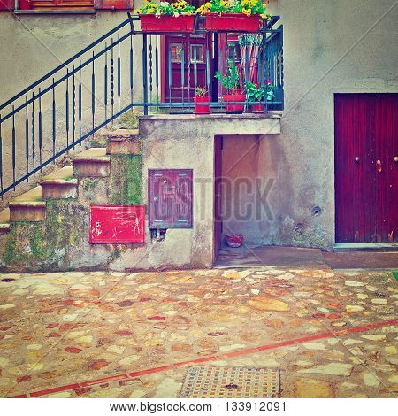 Porch Decorated with Flowers of the Old Buildings in Italian City of Doglio Instagram Effect