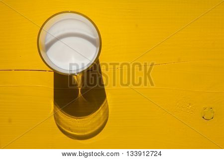 Glass of milk on the yellow wooden table - Flat Lay Photography