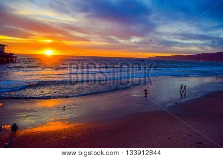 Los Angeles, CA, USA - January 11, 2016: Beach Santa Monica pier at sunset, Los Angeles