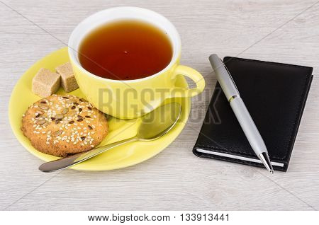 Tea In Cup, Shortbread Cookies, Notepad And Pen