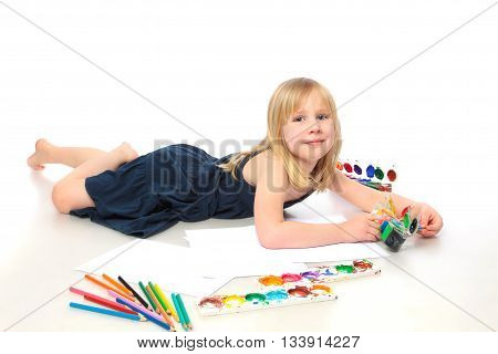 cheerful child with paint end pensil on white