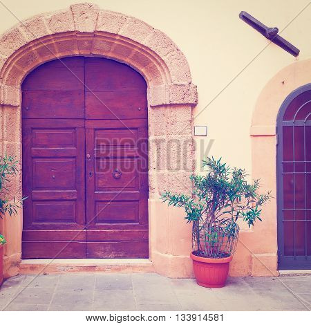Wooden Ancient Italian Door in Historic Center Retro Effect