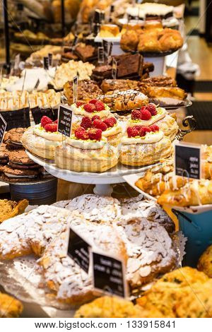 Many Pastries in a Bakery Display case
