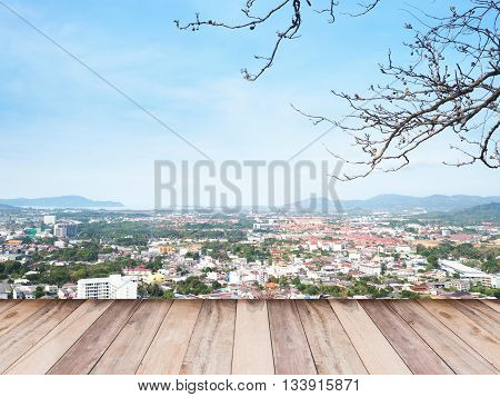 Wooden floor over aerial view of cityscape Phuket province Thailand.